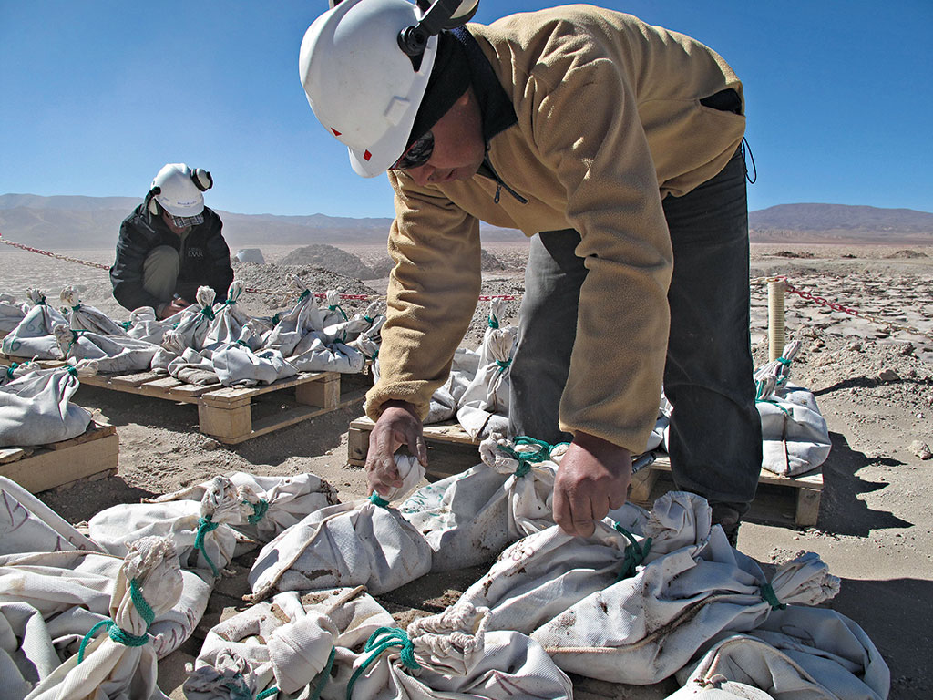 Lithium workers bag and tag brine extracted from an exploratory well in Salinas Grandes, Argentina. Abundant reserves of the mineral have supported the region's economic growth, but its regressive tax system is stifling competitiveness