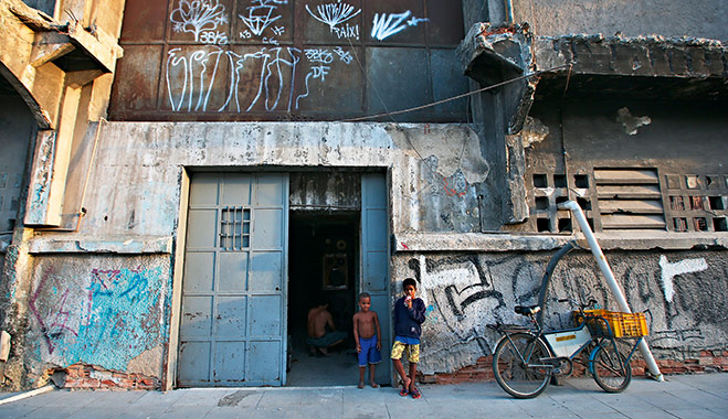 Children in front of a building which houses 82 families in the port district of Rio. Residents will be relocated to new housing ahead of the 2014 World Cup