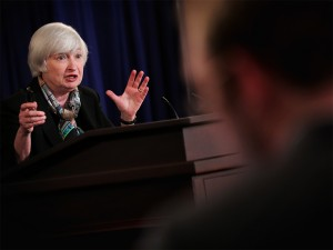 Janet Yellen speaks at a news conference yesterday in which she indicated that the Fed is to rise interest rates sooner than expected