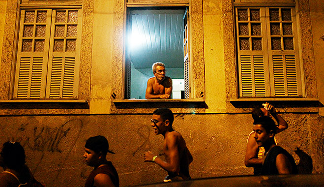 Revellers march through the port district in Rio. It is hoped the redevelopment can help shed the area's party-town image