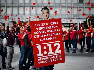 Swiss demonstrators advocating the proposed '1:12' initiative that would have limited executive pay, before it was later defeated in a referendum. Since then, the Swiss have changed tack, channelling their efforts into fighting for unconditional basic income
