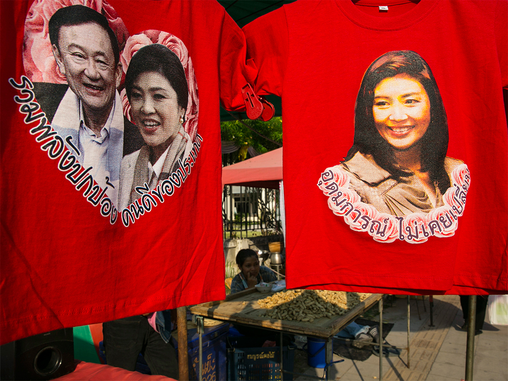 The smiles before the storm: t-shirts of Thailand's current and former prime ministers, Yingluck Shinawatra and Thaksin Shinawatra, respectively. Thailand's political conflicts have greatly damaged foreign investment in the country, leaving many concerned for the future ahead