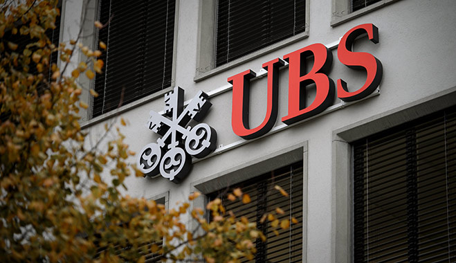 A logo of Swiss banking giant UBS is seen on a building in Zurich