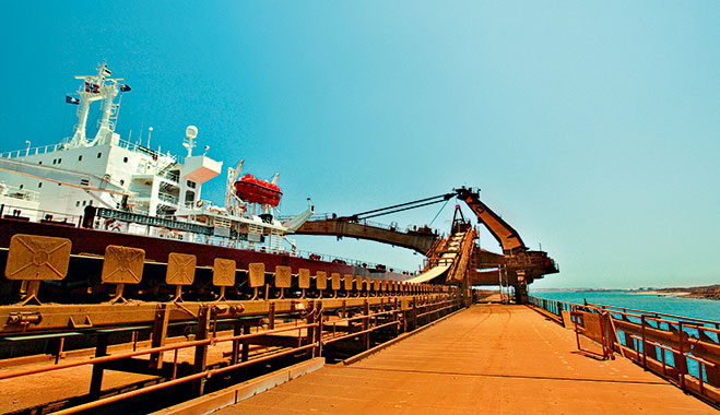 The worlds largest iron ore carrier, the Berge Stahl, is docked at the Rio Tinto port of Dampier, Western Australia
