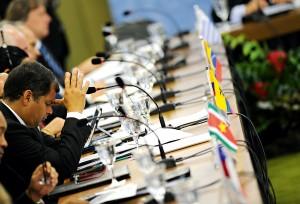 Ecuadorian President Rafael Correa reacts during a summit meeting of the Mercosur trade bloc