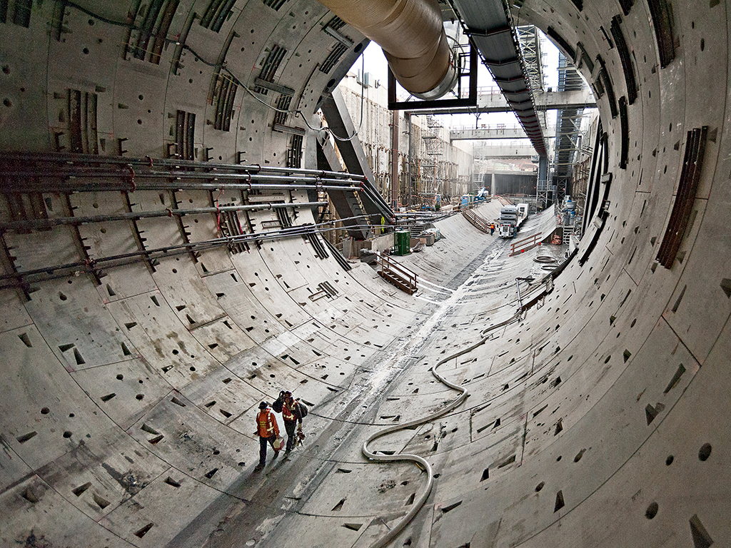 Two workers walk through the first rings of the SR 99 tunnel in October 2013. Image courtesy of Washington State Department of Transportation