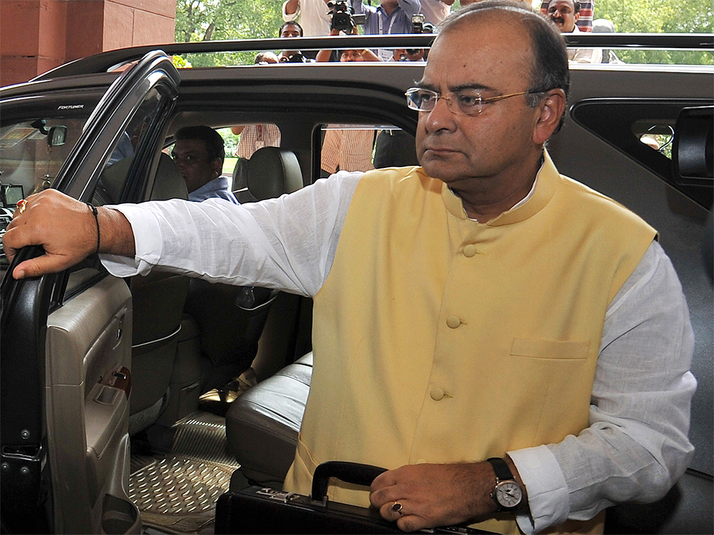 Indian Finance Minister Arun Jaitley arrives at parliament to present the government's 2014 budget