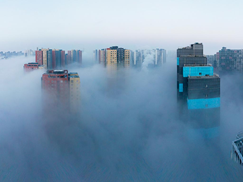 Buildings shrouded in smog in Beijing, China