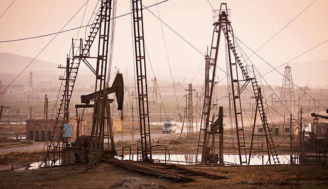 Oil fields on the outskirts of Baku, Azerbaijan. Oil and gas is big business in Azerbaijan, but its government is keen to promote industries such as manufacturing and agriculture to ensure the country's future is sustainable