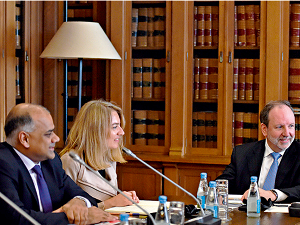 (From L) Subir Lall of the IMF, Isabel Vansteenkiste from the ECB and Head of EU delegation Sean Berrigan listen to Vieira da Silva, Head of the committee nominated by the Portuguese Parliament during a meeting about the financial assistance programme