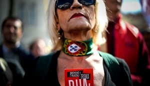 A woman protests against salary cuts and public sector reforms stipulated in the Portuguese government's 2014 budget. There are still challenges ahead for the country's economy - particularly in regards to its unemployment rate - but a financial adjustment programme has helped it in other areas
