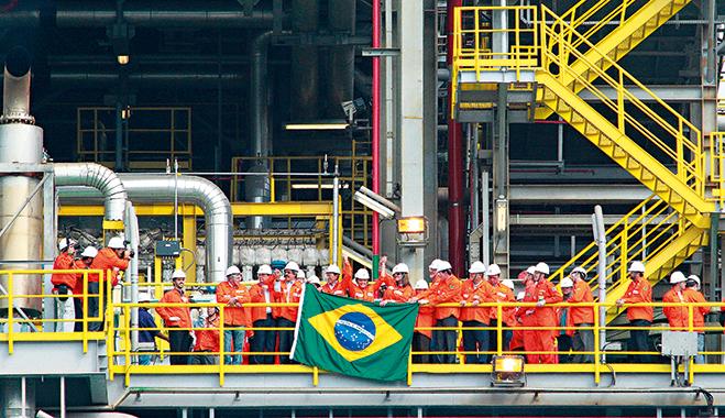 Brazilian President Dilma Rousseff (c) during the inauguration of Petrobras' P-56 platform, at the shipyard in Angra dos Reis, South of Rio de Janeiro