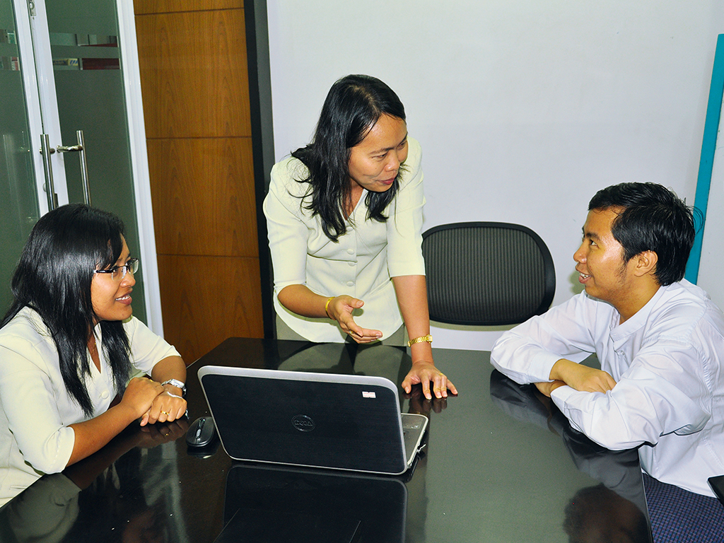 KBZ employees in a meeting at a branch in Myanmar
