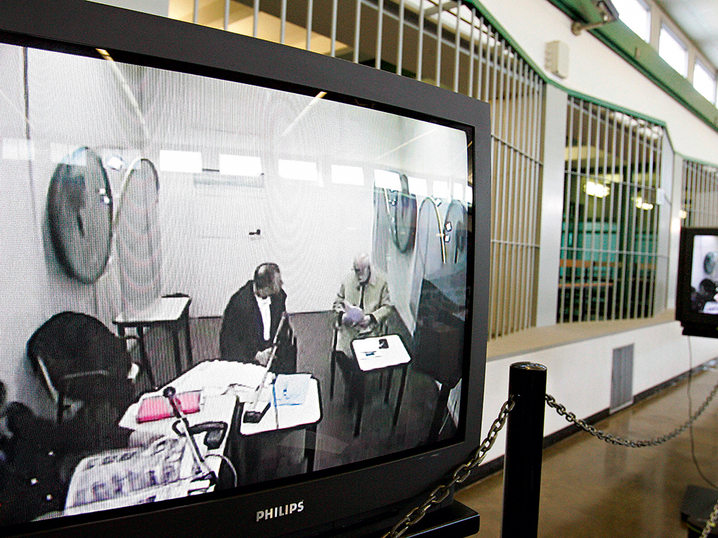 Giuseppe Calo (right on screen) appears by video link from a prison in central Italy during the trial of the alleged murderer of Roberto Calvi, 23 years after his body was found in London