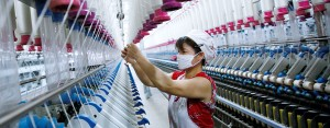 A woman works in a thread factory. Green supply chains are become more and more crucial to businesses