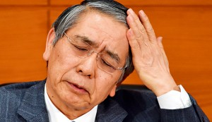 Bank of Japan Governor Haruhiko Kuroda gestures as he answers questions during a press conference at the Bank of Japan headquarters in Tokyo