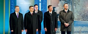 The President of the Bank of Latvia Ilmars Rimsevics (left), Estonian Prime Minister Andrus Ansip (second left), Latvian Prime Minister Valdis Dombrovskis (second right) and Latvian Finance Minister Andris Vilks (right) take part in a ceremony as the country joins the euro