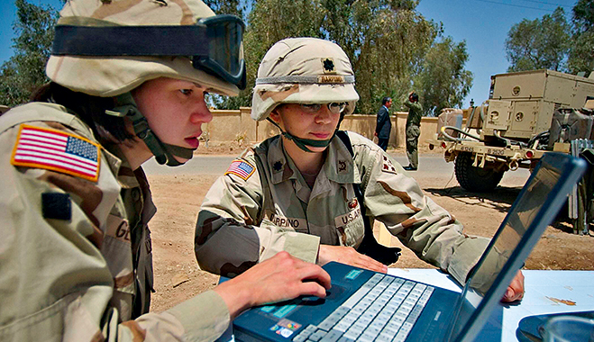US army soldiers using intelligent services in combat. Military strategies can also be applied to corporate data management