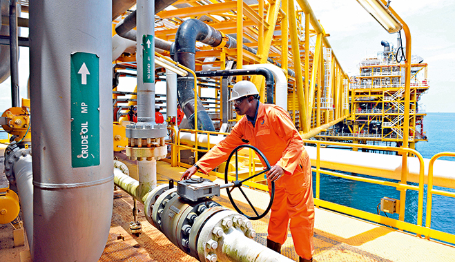 A worker inspecting facilities on an oil drilling platform in Nigeria. The oil and gas sector there has been the largest beneficiary of FDI