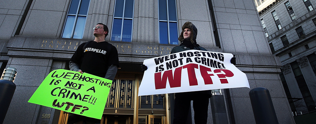 Protestors stand outside court where Ross Ulbricht, 'Dread Pirate Roberts' was found guilty of seven charges, including narcotics-traffiking conspiracy. He was also accused of ordering the assassination of a Silk Road user