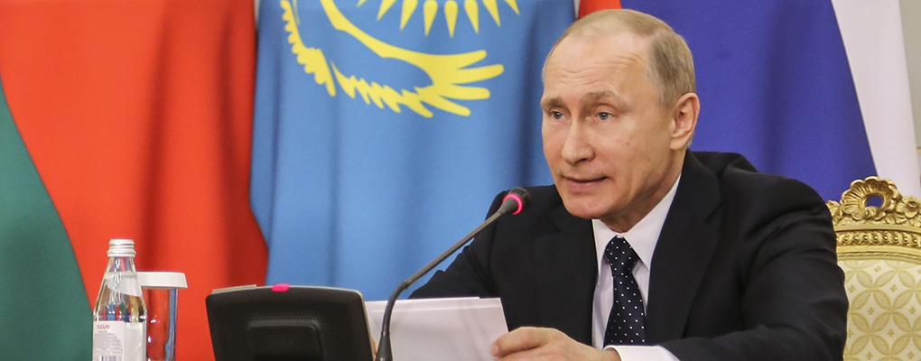 Putin speaks at the Eurasian Economic Union summit in Kazakhstan. The president is keen to unify Russia, Belarus and Kazakhstan's currency