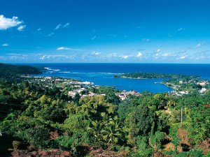 Port Antonio surrounded by tropical forest in Jamaica. The pension sector and infrastructure in the country are both showing signs of development