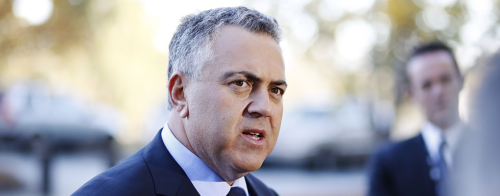 Treasurer Joe Hockey is deeply concerned by Australia's plummeting iron ore prices, which may force him to write-off $25bn in revenue for the next four years