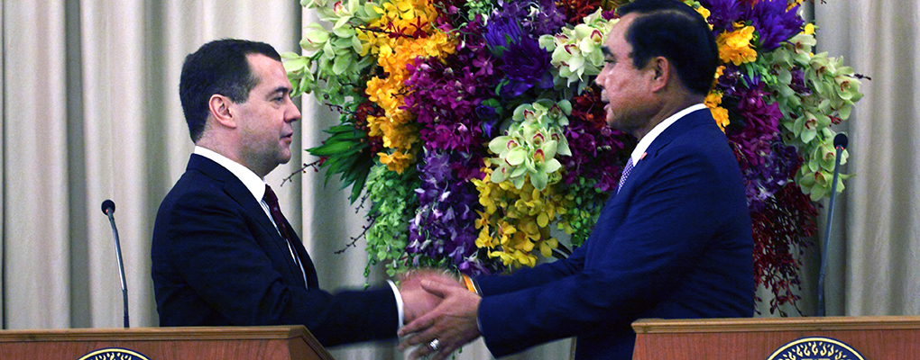 Russian prime minister Dmitry Medvedev (left) shakes hands with Thailand's Prayuth Chan-ocha (right). As Russia's ties with the West diminish, it is increasingly looking to Asia for strength