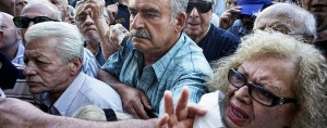 Pensioners fight for money at Greece's national bank. More chaos is to unfold for the country as the government was forced to default on the huge loan it owes the IMF yesterday