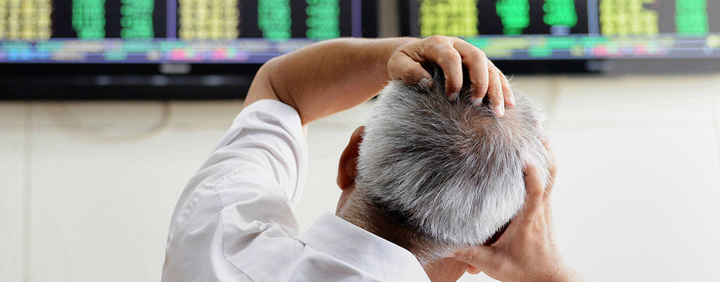An investor monitors the stocks in China yesterday. The country has been in treacherous waters since its economy contracted