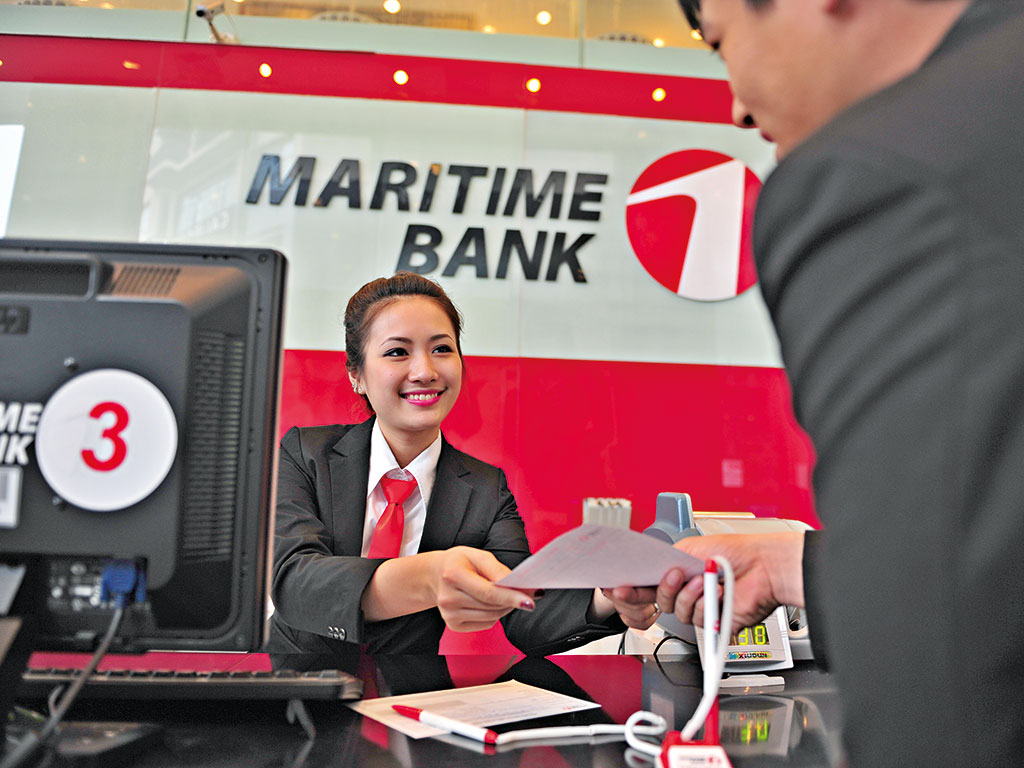 A transaction at a Martime Bank branch, which is based in Vietnam. The country's prospects are improving rapidly thanks to more foreign direct investment