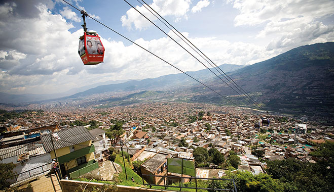 The poor neighbourhoods of Medellin, Colombia, at the foot of the mountains, are linked to the centre by cable car