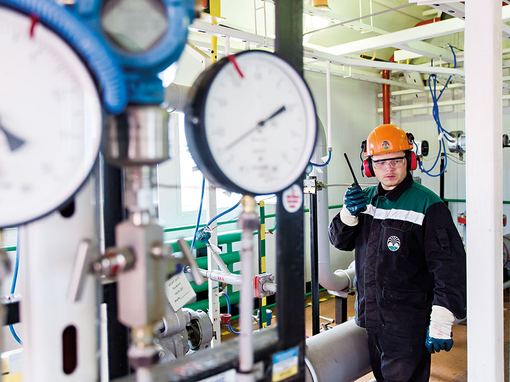 A worker monitors gas pressure at Irkutsk's main oil and gas condensate development, Irkutsk, East Siberia