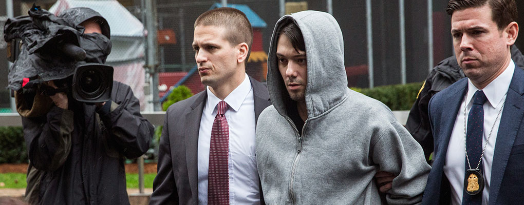 Martin Shkreli, Chief Executive of KaloBios Pharmaceuticals, is led away by security officials