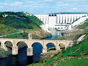 Alcántara hydro power scheme on the Tagus river, Spain, with downstream Roman bridge to the fore