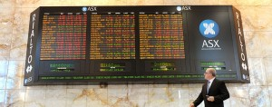 A shares board on display at the Australian Securities Exchange (ASX). The ASX's Chief Executive, Elmer Funke-Kupper, has stepped down from his role following allegations of bribery during his previous role at Tabcorp.