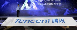 Ren Yuxin, Chief Operating Officer of Tencent, speaks during the 2015 Tencent Open Strategy Annual Conference. Tencent has recently announced a merger with China Music Corp