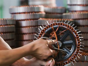 An electric motor is produced by a Chinese factory worker. According to the Caixin PMI, China's service sector declined to 51.7 in July