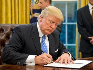 Donald Trump signs the executive order to pull the US out of the Trans Pacific Partnership