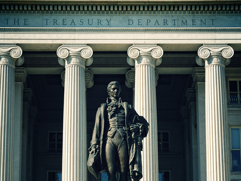 The US Treasury Department adorned by the statue of the first Secretary of the Treasury, Alexander Hamilton