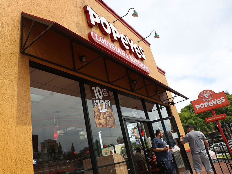 Restaurant Brands International, the owner of Burger King and Tim Hortons, will purchase multinational fried chicken chain Popeyes Louisiana Kitchen for $1.8bn