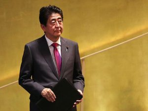 Japanese Prime Minister Shinzo Abe has appointed two new members to the Bank of Japan's board, replacing the last remaining dissenters