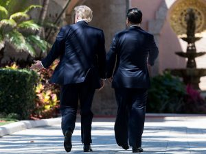 Donald Trump and Xi Jinping walk together at Trump's Mar-a-Lago estate in Florida. The two presidents have agreed to instigate a 100-day plan aimed at addressing the trade deficit between the two countries