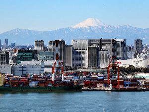 Mount Fuji is seen behind an international cargo terminal in Tokyo, Japan. Japanese exports saw a 14.9 percent annual increase in May