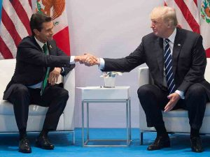 Mexican President Enrique Peña Nieto and US President Donald Trump shake hands at the G20 Summit in July 2017. Mexico appears to be examining possible revisions to NAFTA ahead of next month's talks
