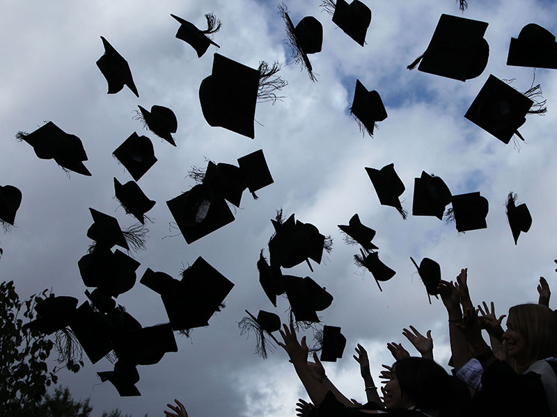 Students graduating from the University of Birmingham, UK. As student debt in both the UK and the US reach unprecedented levels, experts warn that both loan systems require a dramatic overhaul