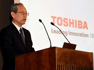 Satoshi Tsunakawa, CEO of Toshiba, speaks at a press conference in June 2017. Following an eight-month bidding war, the company has finally agreed to the sale of its memory chip unit