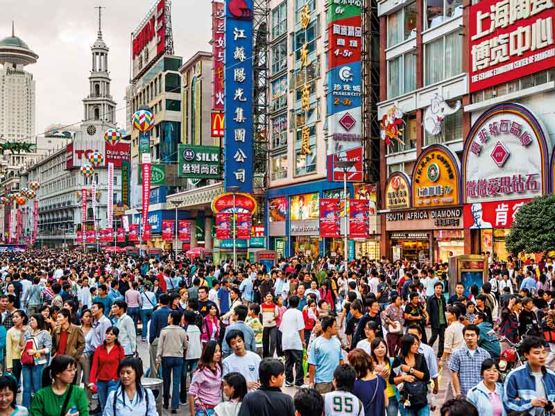 Nanjing Road in Shanghai. Crowds are common in Chinese cities, as the country has a population of almost 1.5 billion