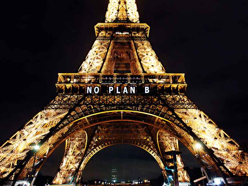 The Eiffel Tower displays messages during the COP21 climate summit in Paris