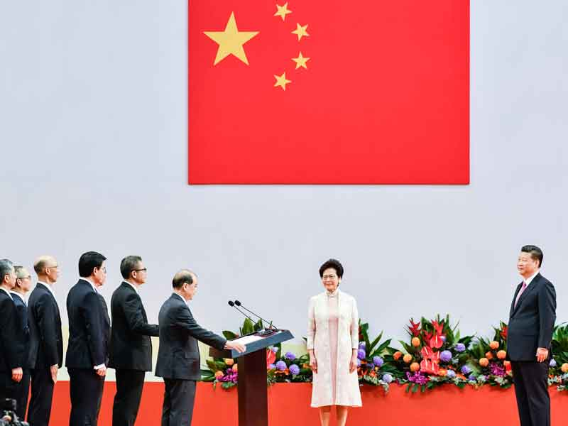 Carrie Lam is sworn in by President Xi Jinping during her inauguration in Hong Kong in July